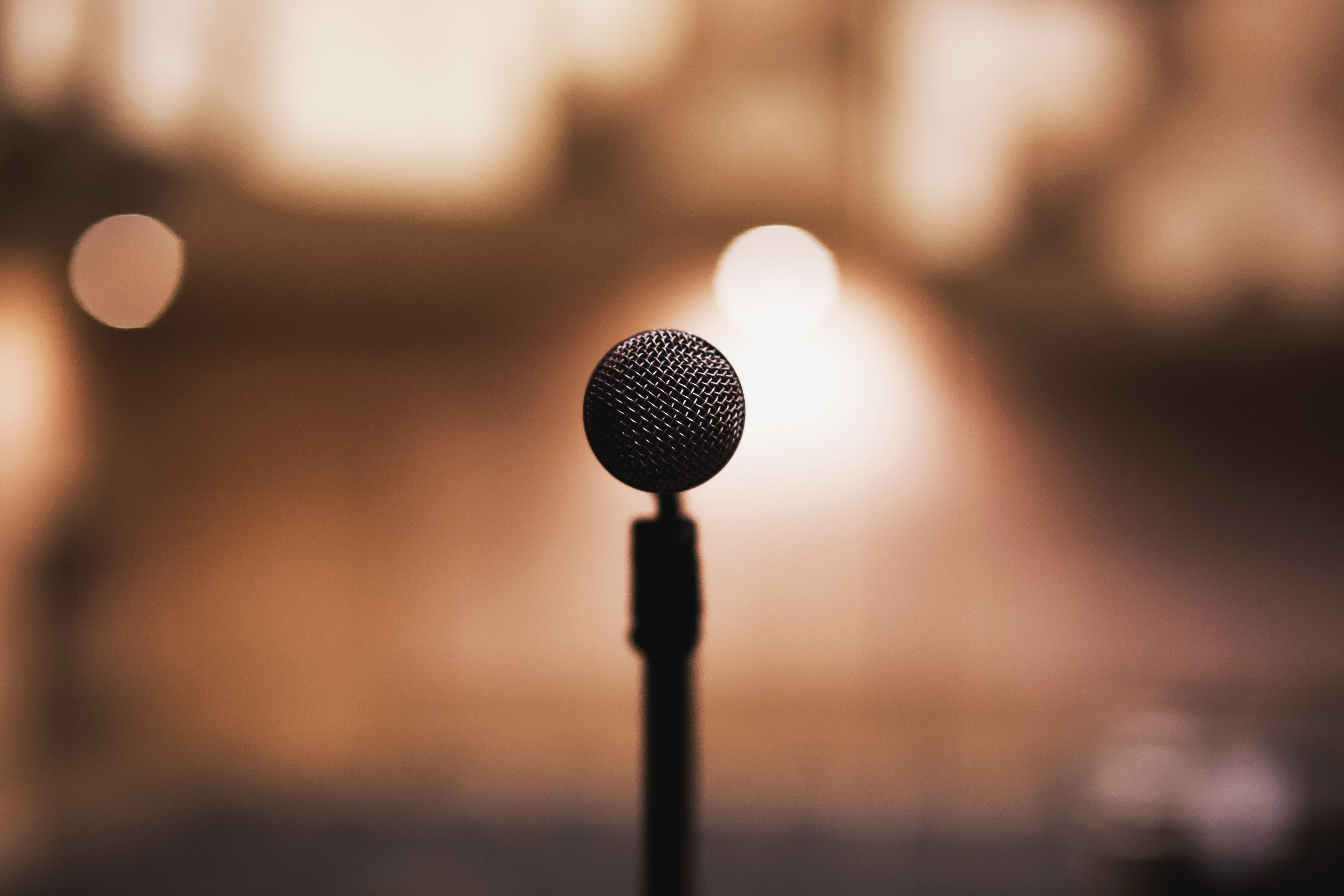 microphone on a microphone stand with blurred theatre in background