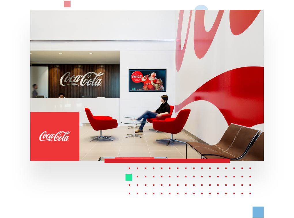 picture of a Coca Cola office, portraying a visitor in the reception area in order to illustrate the Coca Cola testimonial